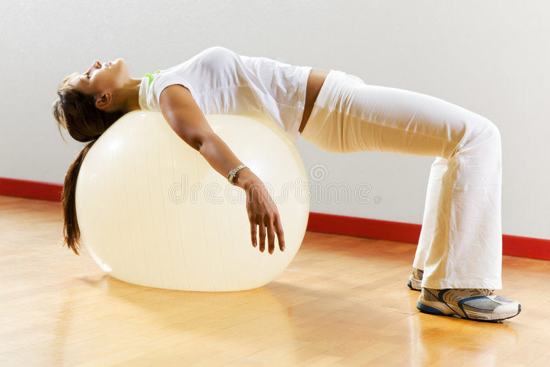 Health club. Woman doing stretching and aerobics royalty free stock photos