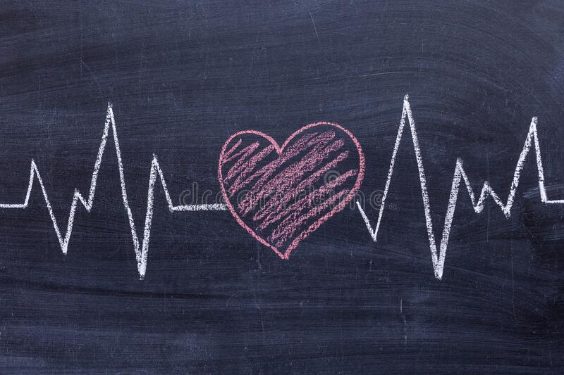 Health concept . Drawing of the heart and pulse diagram on a chalk Board.  stock images