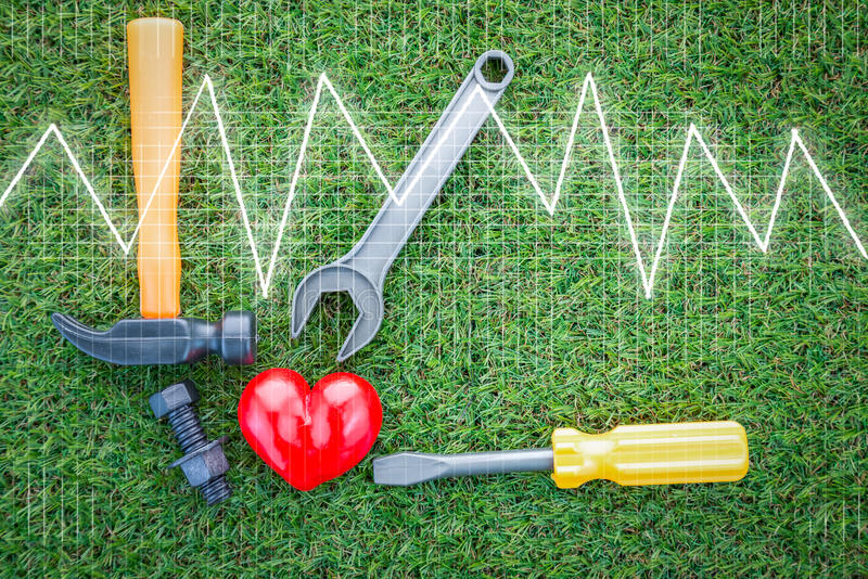 Health concept with red heart and tools with Heart cardiogram gr stock photos