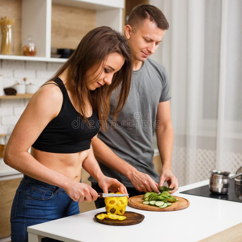 Health-conscious couple cooking healthy food. Diet, healthy eating, fitness lifestyle, proper nutrition. health conscious couple cooking low calorie dinner in stock photo