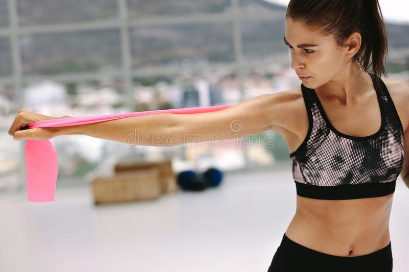 Health conscious woman exercising with resistance band royalty free stock photography