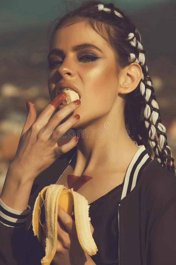 Health and diet, healthy dieting. Cute woman with stylish makeup eating vitamin banana. Health and diet, healthy dieting. girl with banana. Cute woman or pretty stock photography