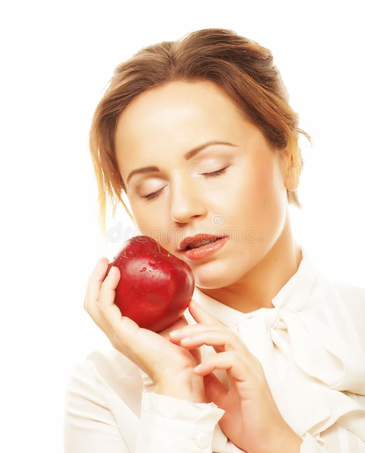Health, diet and people concept: young woman holding red apple stock photo