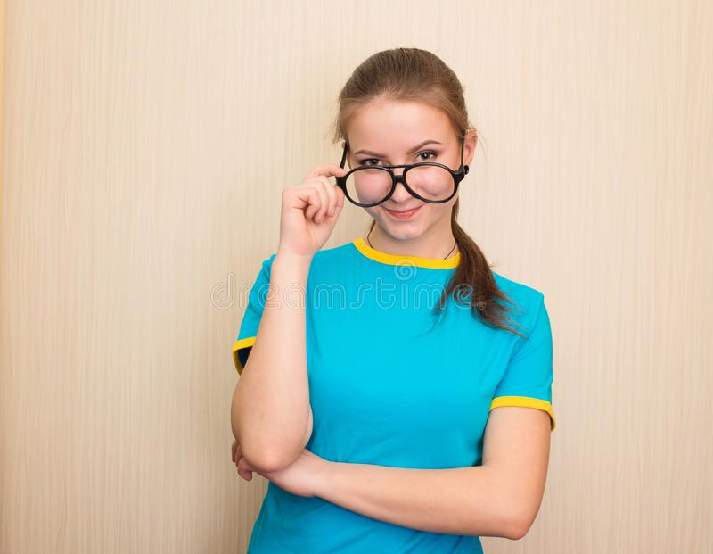 Health, education and people concept. Happy teen girl in eyeglasses isolated.  stock photos