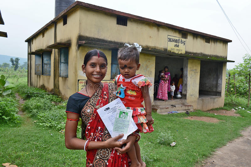 Health Facility. A underprivileged patients posed with health card at a rural health center of Bihar-India stock photo