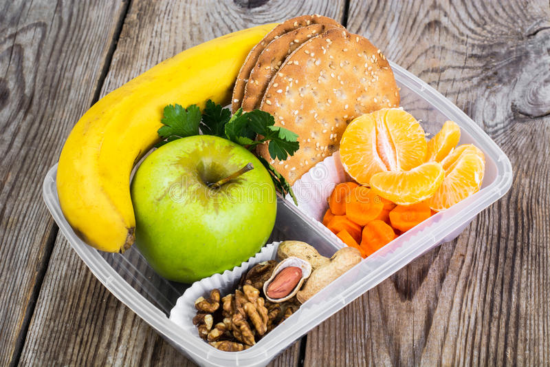 Health and Fitness food in lunch box on wooden background. Studio Photo royalty free stock photography