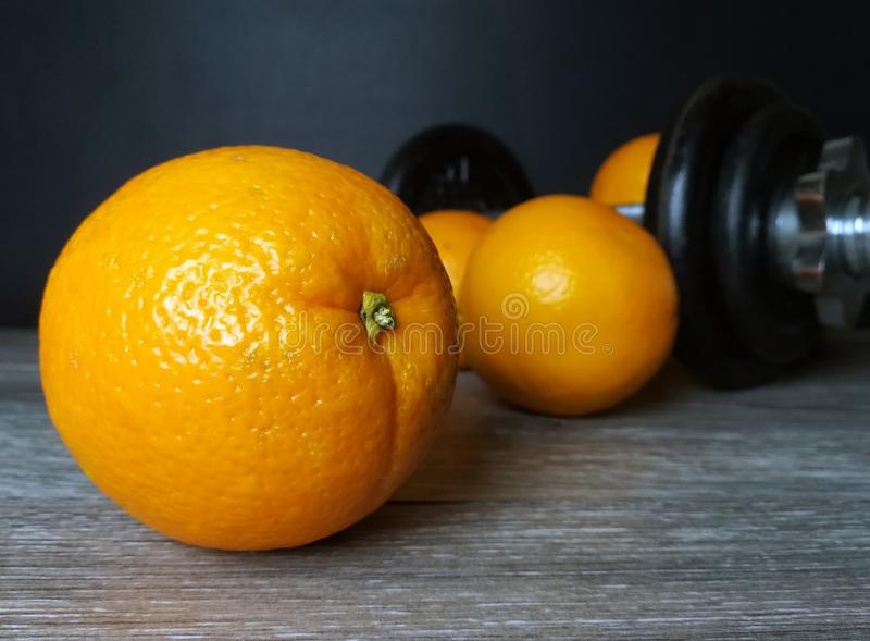 Orange with weights, health and fitness stock image