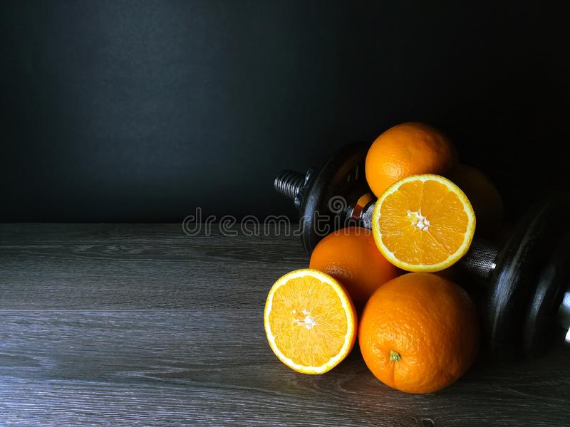 Orange with weights, health and fitness royalty free stock photography