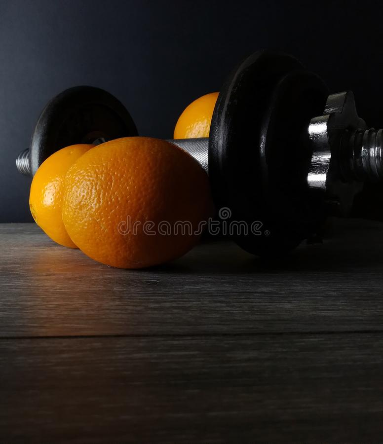 Orange with weights, health and fitness royalty free stock photo