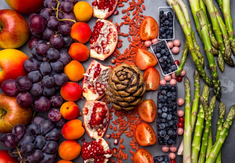 Health food for fitness concept with fruit, vegetables, nuts High in anthocyanins, antioxidants, minerals and vitamins royalty free stock photo