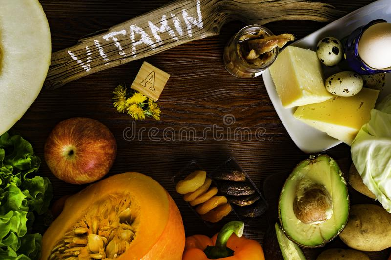 Vitamin A in food, Natural products rich in vitamin A as pepper, pumpkin, apple, potato, cabbage, avocado,dried apricots, melon, c. Health food with fruit royalty free stock images