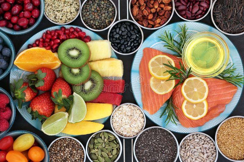 Health Food for a Healthy Heart. With fresh vegetables, fruit, nuts, seeds, pulses, grains, cereals, herbs and olive oil. Super food concept high in omega 3 stock photos