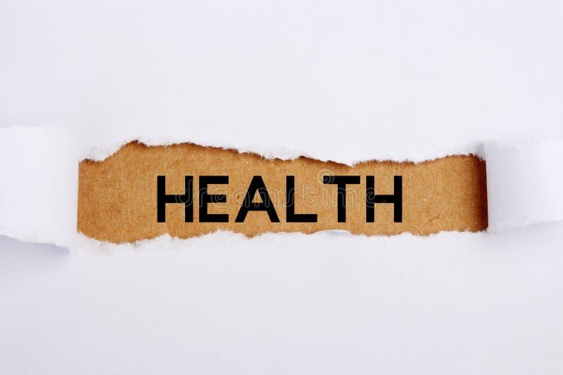 Health Headline. Headline Health on brown paper under white tear drop royalty free stock images