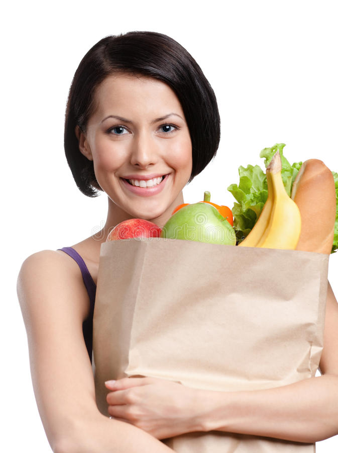 Health improving. Attractive girl with the packet of fruit and vegetables, Isolated, white background. Health improving stock images