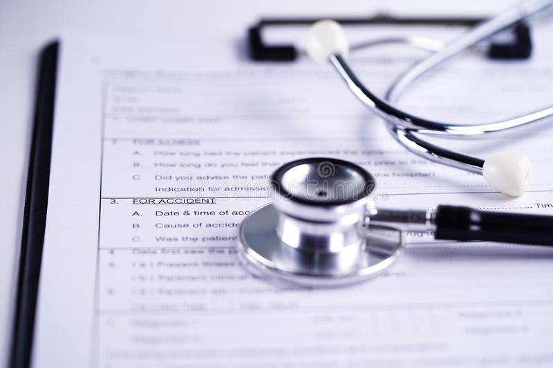 Health insurance accident claim form with stethoscope, Medical concept. Health insurance accident claim form with stethoscope, Medical concept on white stock photo