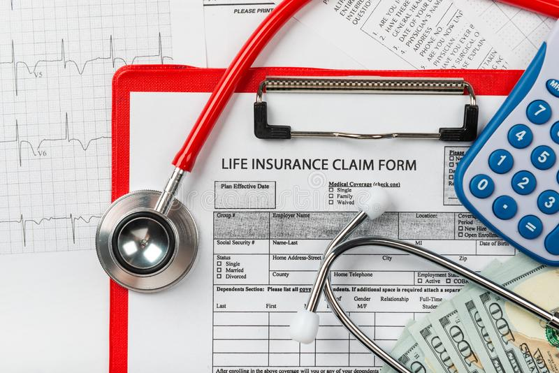 Health insurance application form with banknote and stethoscope. Concept for life planning royalty free stock images