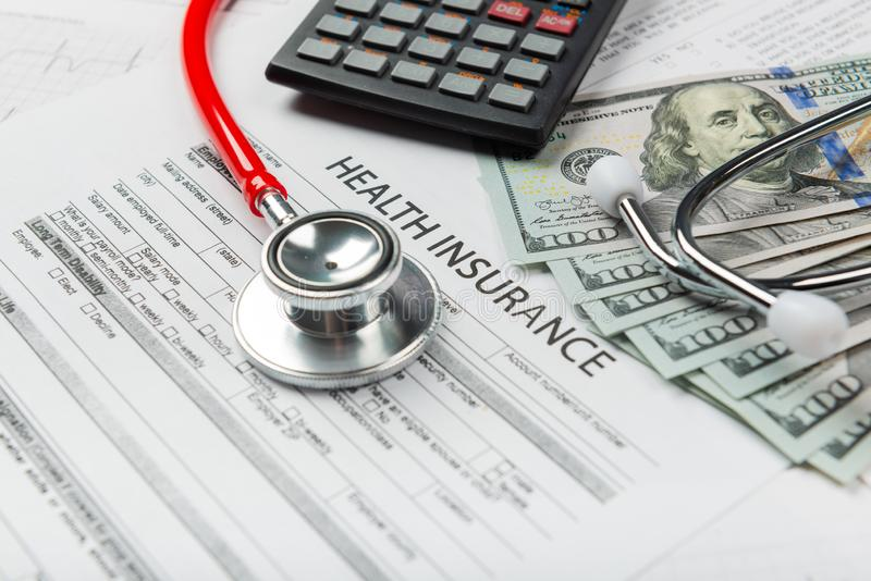 Health insurance application form with banknote and stethoscope. Concept for life planning stock photos