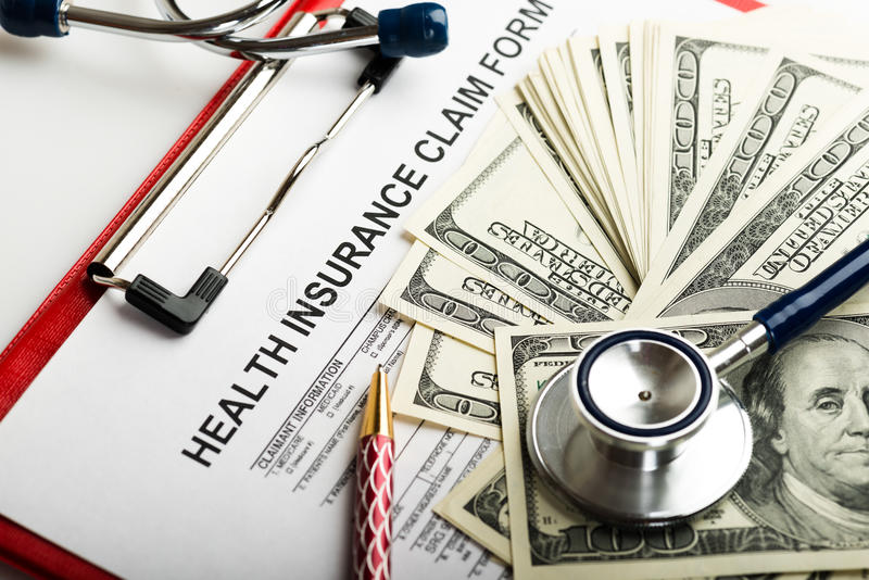 Health insurance application form. With banknote and stethoscope concept for life planning royalty free stock photo