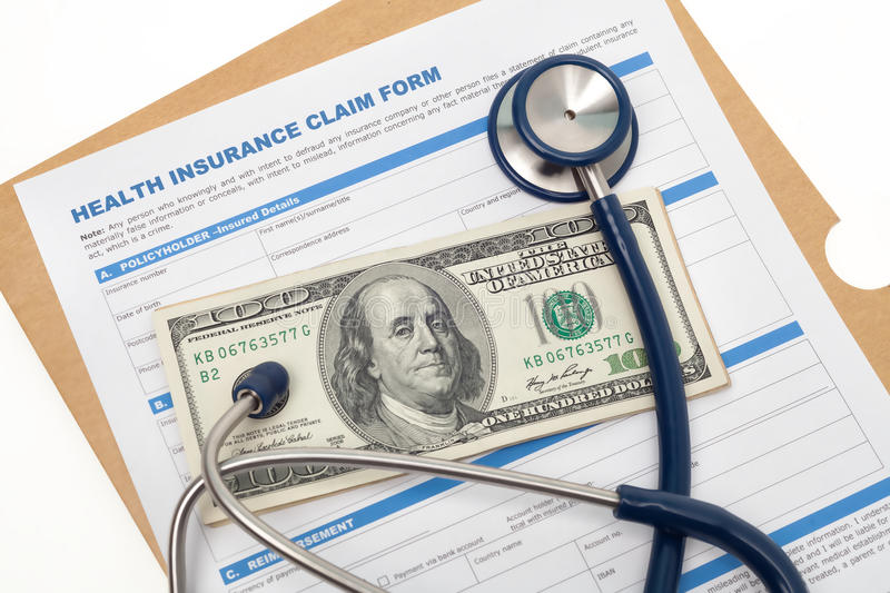 Health insurance claim and cash. Medical reimbursement with health insurance claim form and stethoscope on cash isolated stock photos