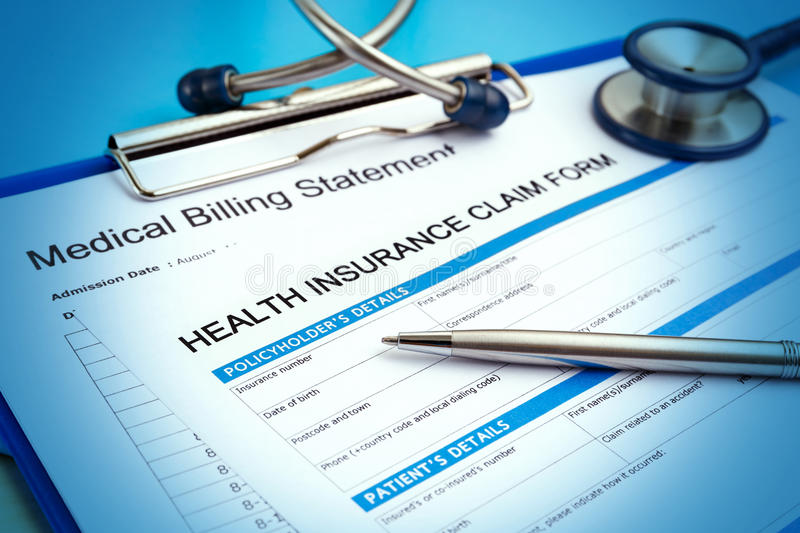 Health insurance claim form. With medical bills and pen royalty free stock photos