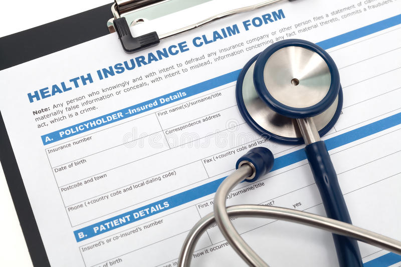Health insurance claim. Medical and health reimbursement with stethoscope on clipboard stock photography