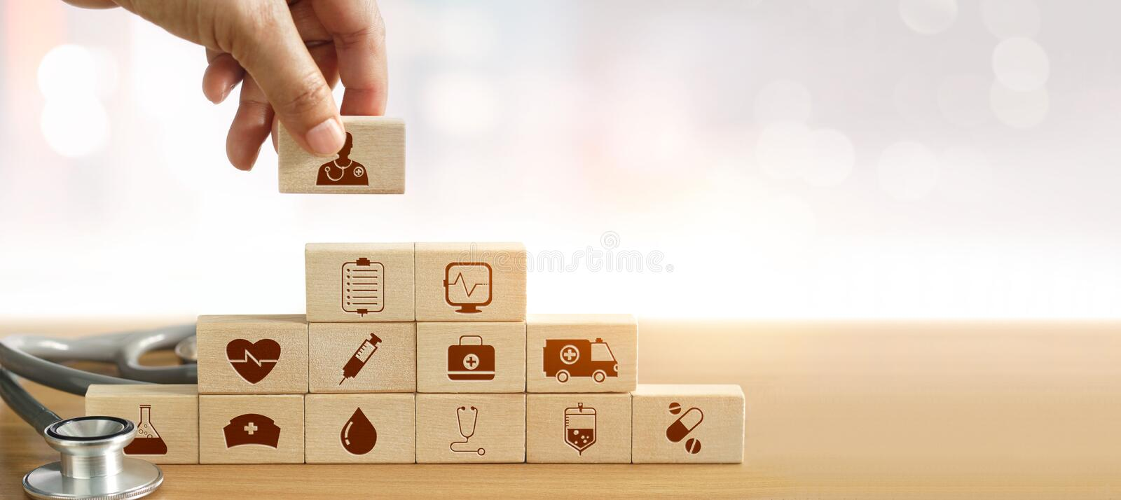 Hand of medicine doctor holding wood block stacking stock photo