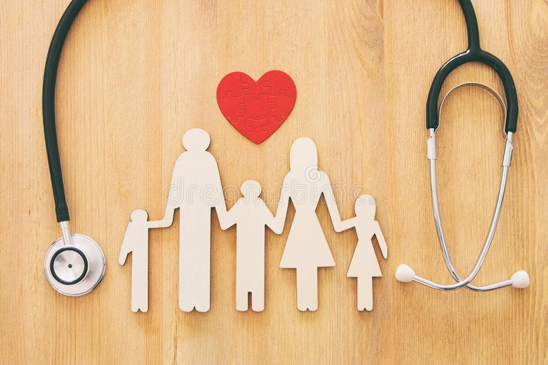 Health Insurance . concept image of Stethoscope and family on wooden table. top view. royalty free stock photos
