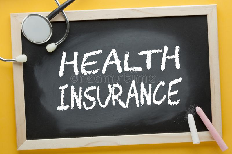 Health Insurance Concept. Health Insurance written on blackboard by color chalks and stethoscope. Medical concept stock images