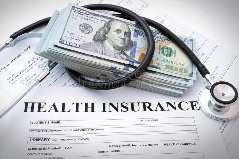 Health insurance. Form with dollars and stethoscope royalty free stock photo