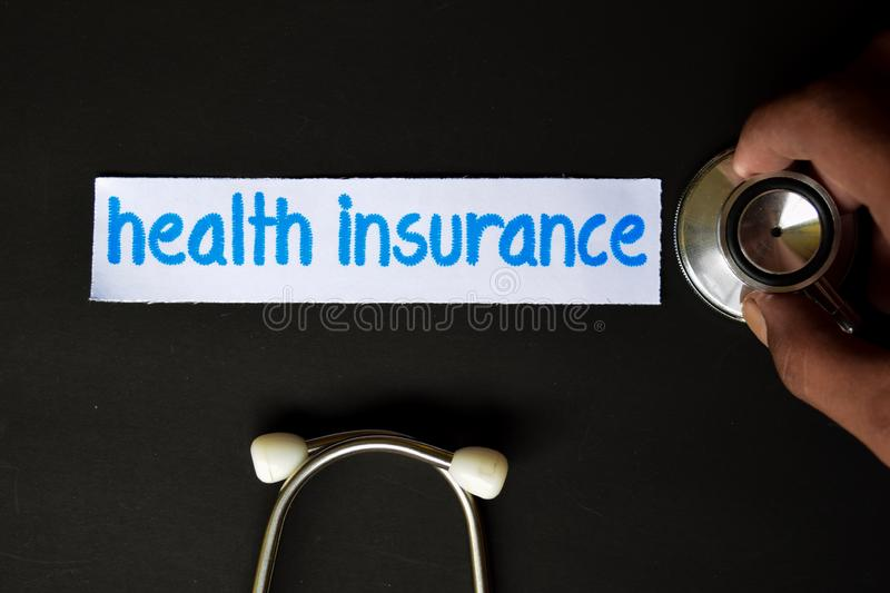Health insurance inscription with the view of stethoscope royalty free stock photo