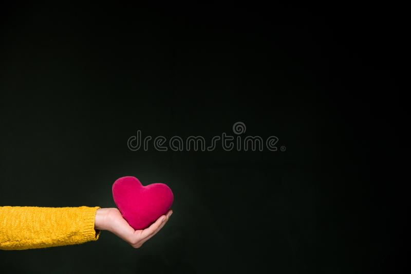 Health insurance or love concept with hand and heart stock images