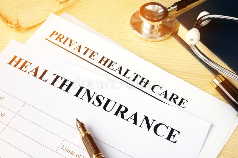 Health insurance policy for private health care. stock images