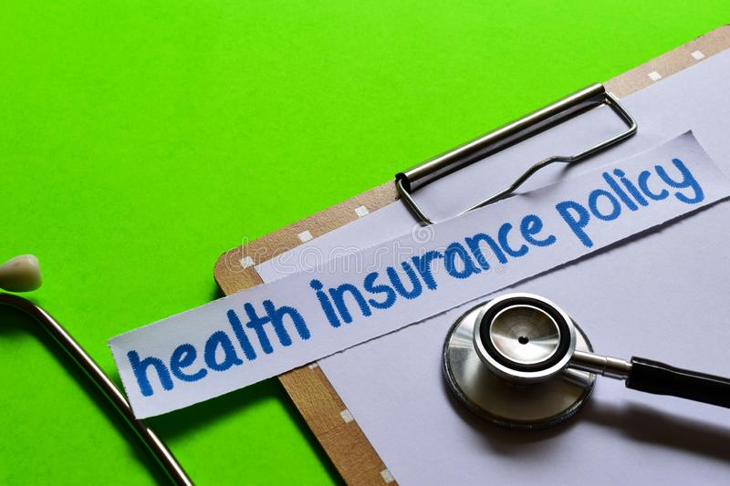 Health insurance policy on Healthcare concept with green background stock photo