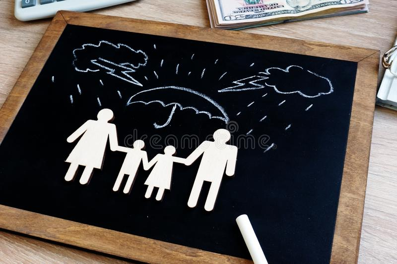 Health and life insurance. Blackboard with family figures in the agency stock image