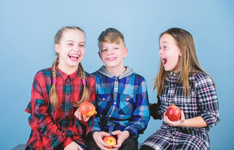 Health is our friend. Cute little children holding red apples. Natural food is good for childrens health. Health food. Store. Eating fruits and vegetables royalty free stock photos