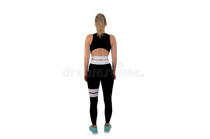 Health, people, Sport and lifestyle concept - Young happy fitness girl with sporty body at studio on a white background. - Image royalty free stock image