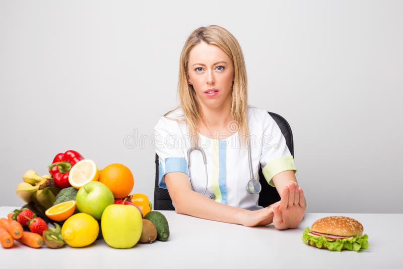 Health professional promoting to eat healthy. Foods royalty free stock photos