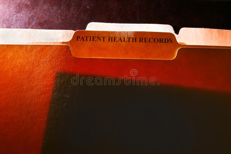Health records folders. File folders with Patient Health Records label royalty free stock photo