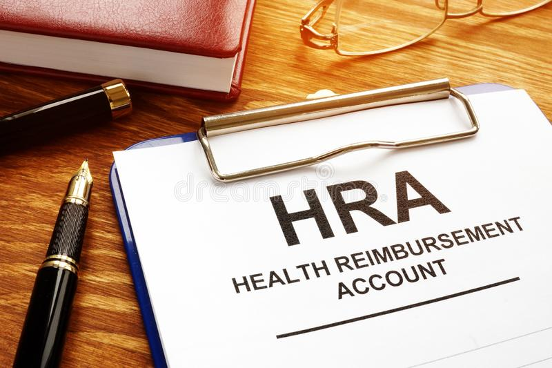 Health Reimbursement Account HRA with clipboard. Health Reimbursement Account HRA with clipboard on desk royalty free stock images