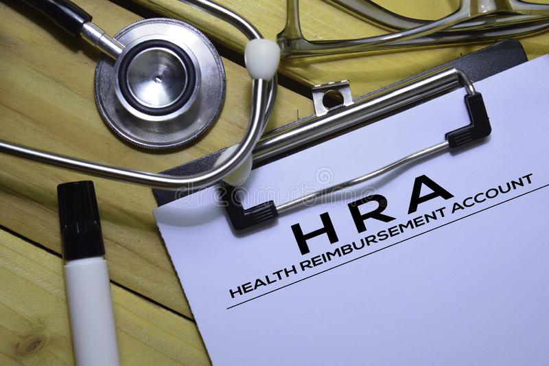 Health Reimbursement Account HRA text on Document form isolated on office desk. stock images