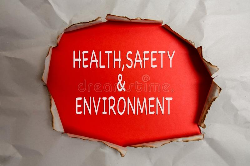 HEALTH, SAFETY AND ENVIRONMENT CONCEPT text at plain torn paper. HEALTH, SAFETY AND ENVIRONMENT CONCEPT text at plain torn paper stock photos