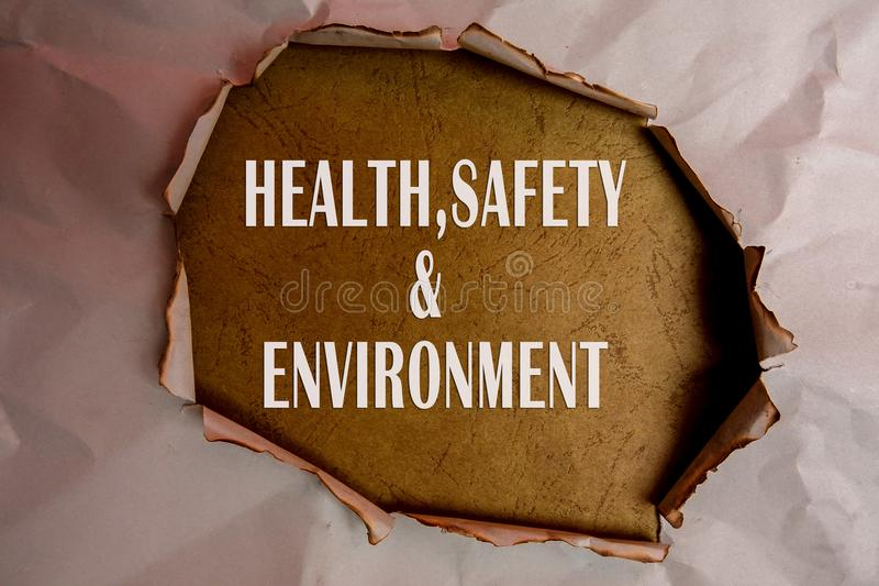 HEALTH, SAFETY AND ENVIRONMENT CONCEPT text at plain torn paper. HEALTH, SAFETY AND ENVIRONMENT CONCEPT text at plain torn paper stock photo