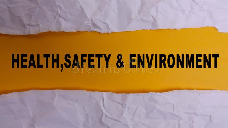 HEALTH, SAFETY AND ENVIRONMENT CONCEPT text at plain torn paper. HEALTH, SAFETY AND ENVIRONMENT CONCEPT text at plain torn paper royalty free stock image