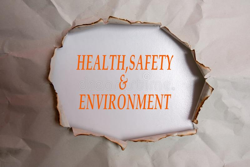 HEALTH, SAFETY AND ENVIRONMENT CONCEPT text at plain torn paper. HEALTH, SAFETY AND ENVIRONMENT CONCEPT text at plain torn paper royalty free stock images