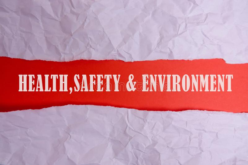 HEALTH, SAFETY AND ENVIRONMENT CONCEPT text at plain torn paper. HEALTH, SAFETY AND ENVIRONMENT CONCEPT text at plain torn paper royalty free stock photo