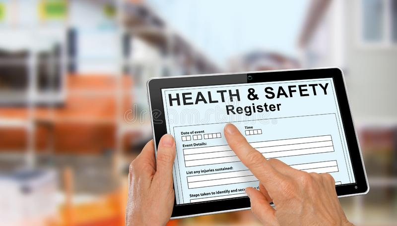 Health and Safety Register with incident report on computer tablet royalty free stock images