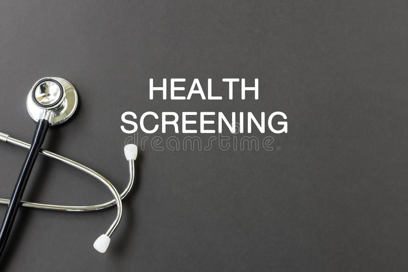 Health screening. Text with stethoscope , health and medical concept royalty free stock image