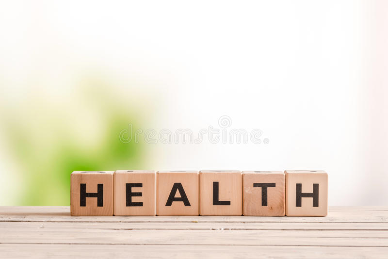 Health sign on a natural desk royalty free stock images