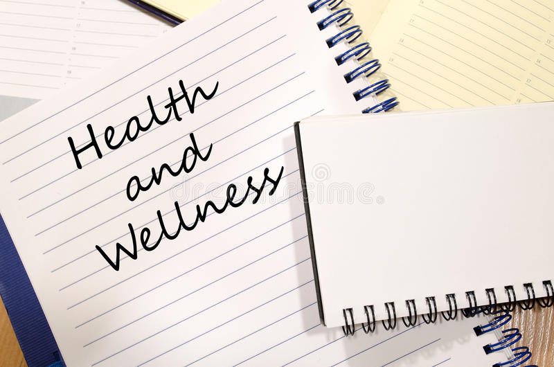 Health and wellness write on notebook royalty free stock photo