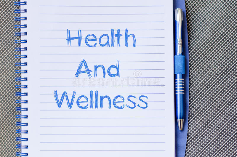 Health and wellness write on notebook stock image
